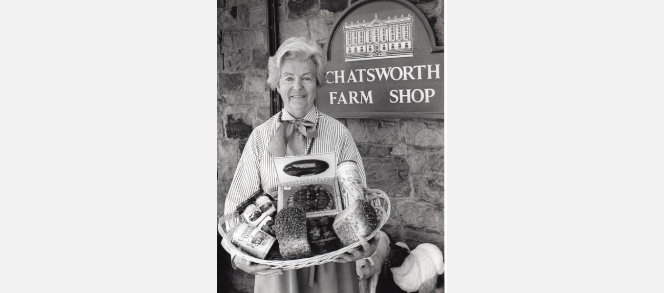 Duchess Deborah with a basket of produce from the estate farm shop